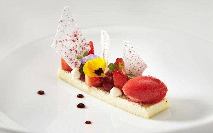 The Latymer's Tahitian vanilla custard, English strawberry spheres and sorbet, mint panna cotta with vanilla meringue