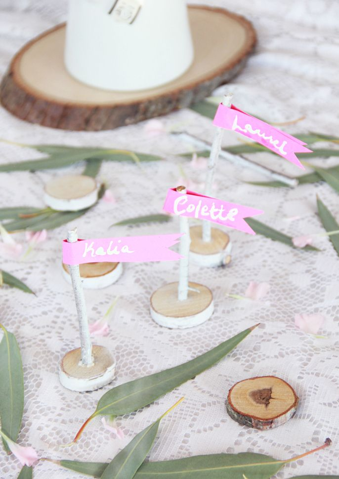 If you're going for a rustic party theme, these DIY twig name tag flags from A Bubbly Life will do the trick. Use tree branches from your own yard to save money and personalize this craft. Click in to learn more.