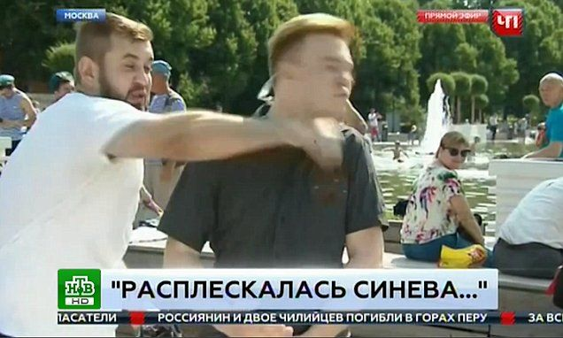 Russian reporter channel is punched in the face live on air