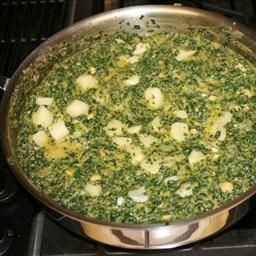 Indian Spinach (saag Panir) on BigOven: A different and delightful creamed spanich dish that is easy to fix as well as pleasing to the taste. Great serverd with Tandoori Chicken.