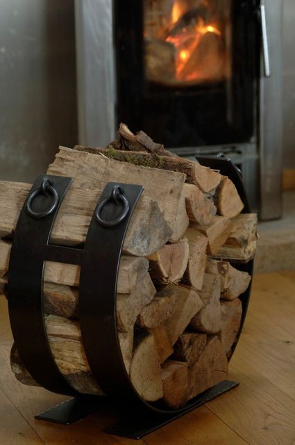 Add some heat to that fire place with this cool log holder #iron log holder                                                                                                                                                      More