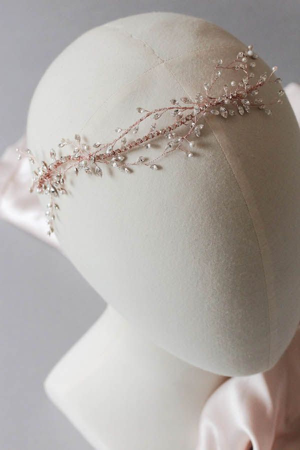 A bespoke rose gold bridal headpiece with rhinestones