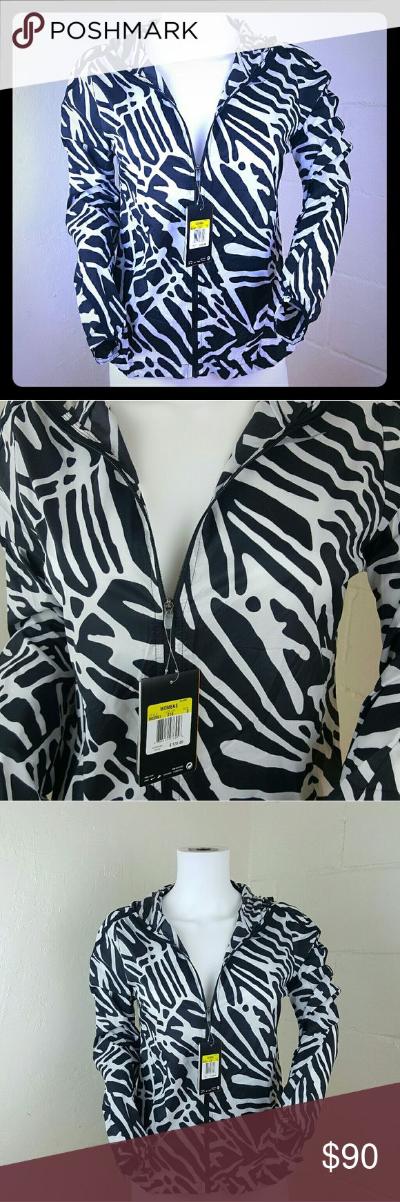 Nike Impossibly Light Womens Running Jacket (NWT) BRAND NEW WITH TAGS  Size - Small  Black & White  No damages Originally  $120.00  The hood has a piece that allows you to roll the jacket easily into small size to carry with you on the go.  * You can also find leggings,shoes,etc that match this palm pattern to wear together!*  The Nike Palm Impossibly Light Women's Running Jacket is updated with nylon fabric that's backed with acrylic for even greater resistance to wind and rain. The jacket…