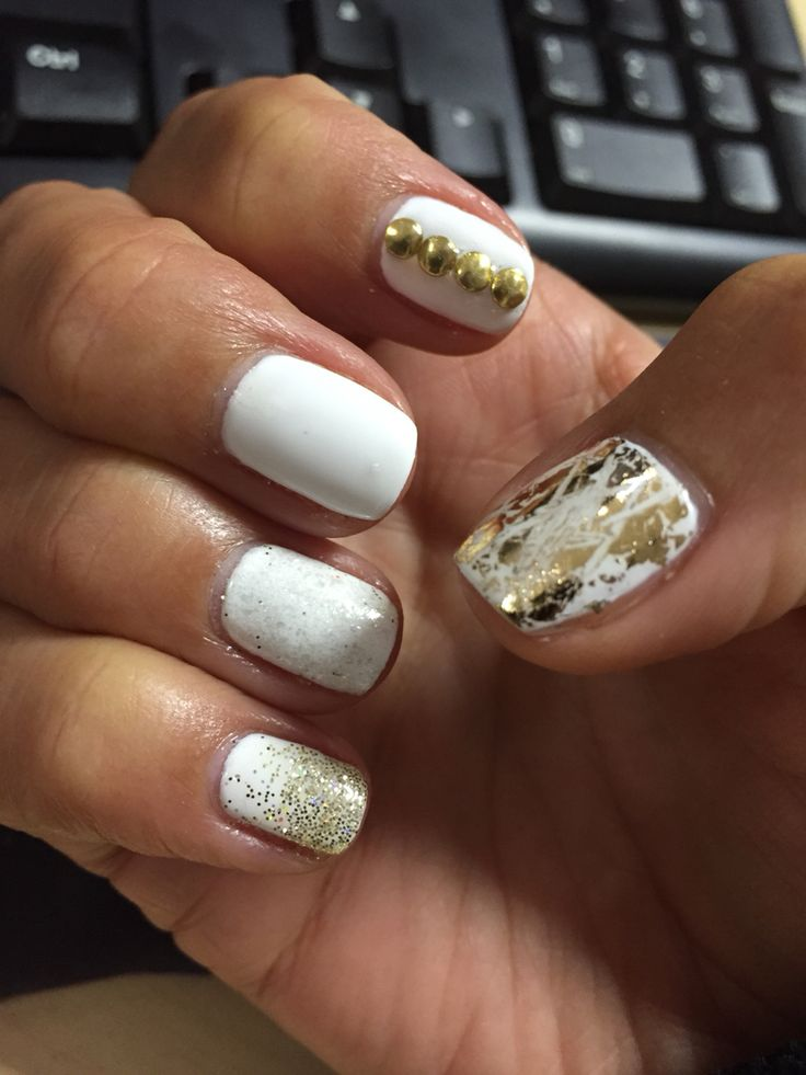White shellac nails with gold additives and accessories