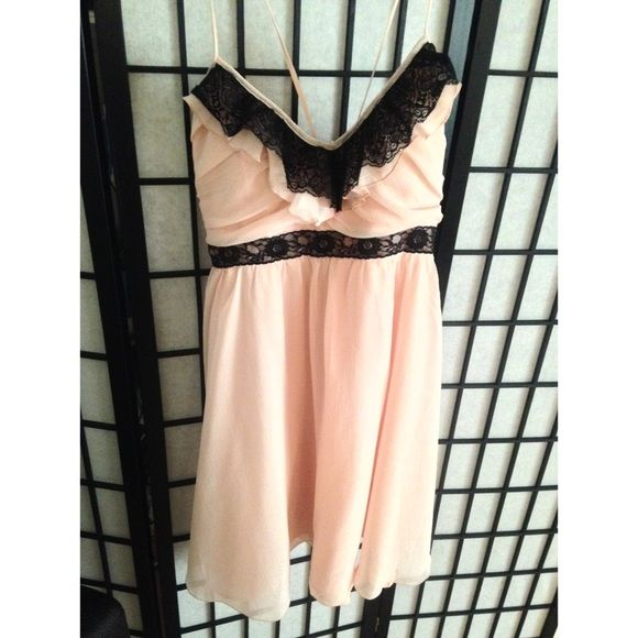 Candies curtain call pale blush dress/ black lace NWT PALE BLUSH DRESS. Size: L  Spaghetti straps Bought new and never worn. Very cute dress sad I couldn't wear it. Has some padding so bra not needed for those with a smaller size. May not be good for bigger bra sizes. Candie's Dresses