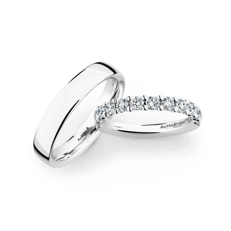 Mit Diamanten besetzter Damen-Ehering und passender Herren-Ehering. Jeweils in Gold und Platin erhältlich!
