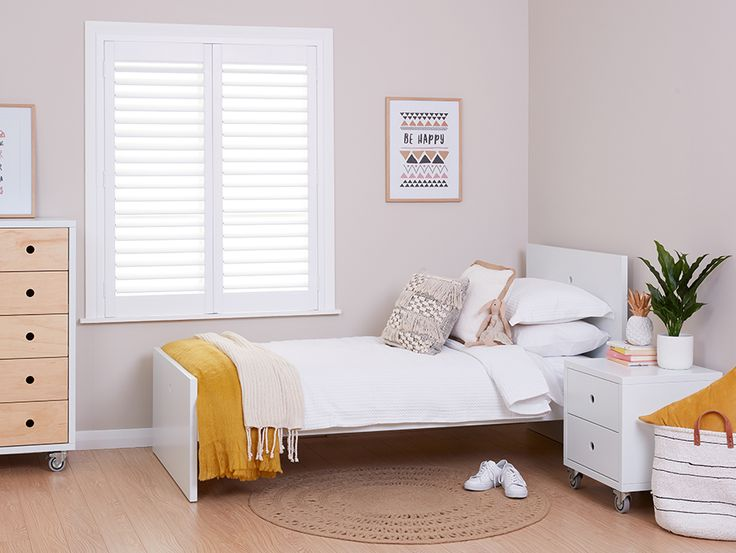 Girls bedroom with hinged shutters