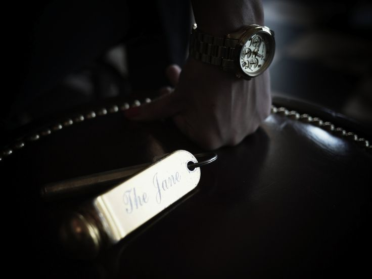 Gold Michael Kors watch, vintage hotel key chain, The Jane Hotel