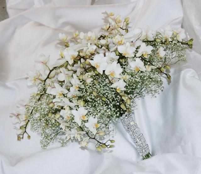 Perlegården:  Brudebukett med brudeslør og orkideer.  Brudedek...