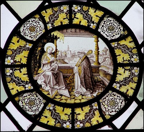 The Blessed Virgin and Child with a Bishop | St Mary's church, Swardeston, Norfolk  Edith Cavell, shot by the Germans in 1915, was the daughter of the Rector here. This is a 17th century continental roundel depicting the lactation miracle of St Bernard.
