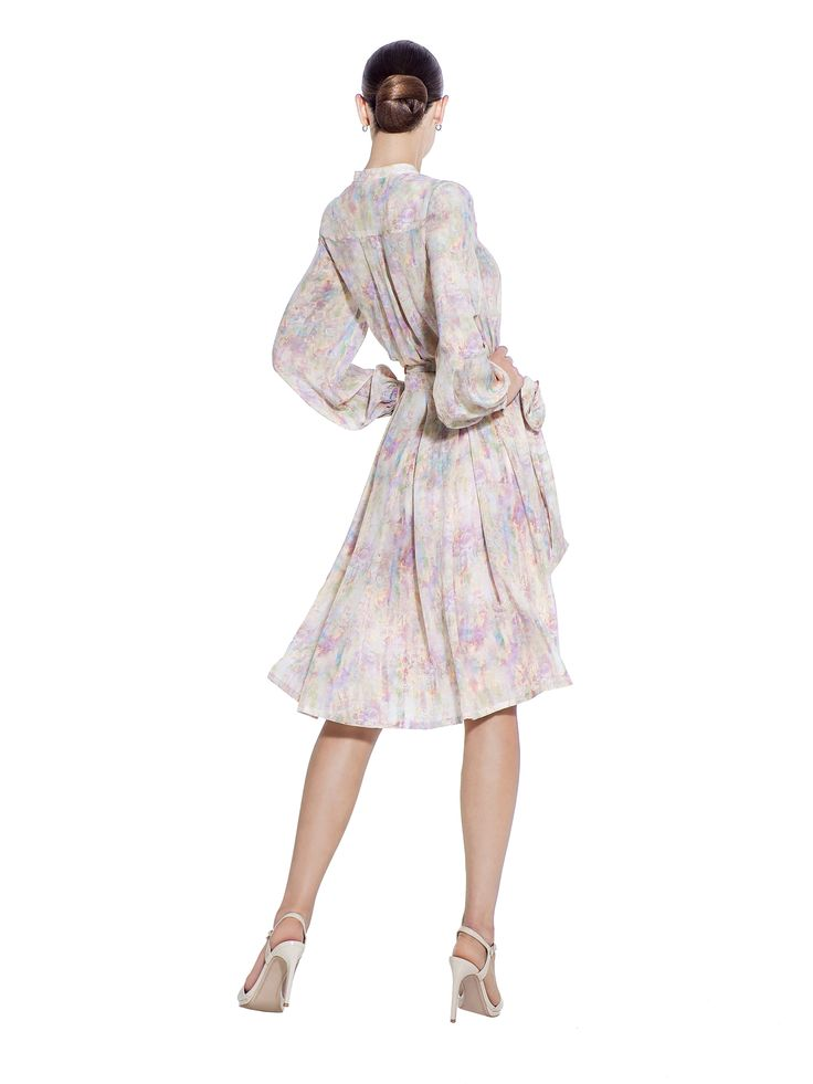 Light and dreamy with a bubble print, this 100% silk crepe de chine dress features bell cuffed sleeves, a high mandarin collar and a bow belt round the waist to style as you need. Fabric imported from South Korea: 100% Silk Crepe de Chine Lining imported from Germany: 57% Viscose 40% Polyimide 3% Elastane Washcare: Dry clean MADE IN EUROPE