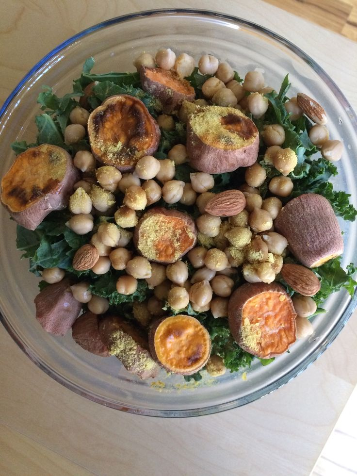 Oil-Free Salad of kale, raw almonds, chickpeas, baked sweet potato slices, nutritional yeast flakes, & balsamic vinegar