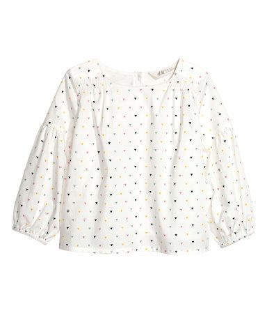 White/patterned. PREMIUM QUALITY. Blouse in woven fabric made from pima cotton. Opening and button at back of neck, smocking at shoulders, and long balloon