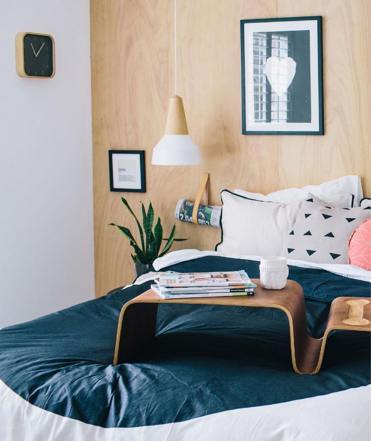 Love the accent pillows and the modern breakfast in bed table