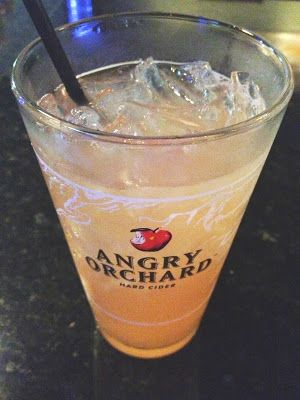 Rum, pineapple juice, splash of grenadine, top 'er off with Angry Orchard crisp apple ale...Yummmmmy!