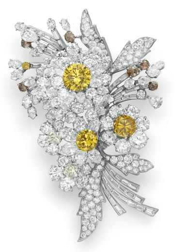 BVLGARI diamond brooch formerly owned by Elizabeth Taylor http://www.christies.com/lotfinder/jewelry/a-colored-diamond-and-diamond-flower-brooch-5507929-details.aspx?from=salesummary=5507929=693b312a-581f-490c-a4c7-e581f748211a