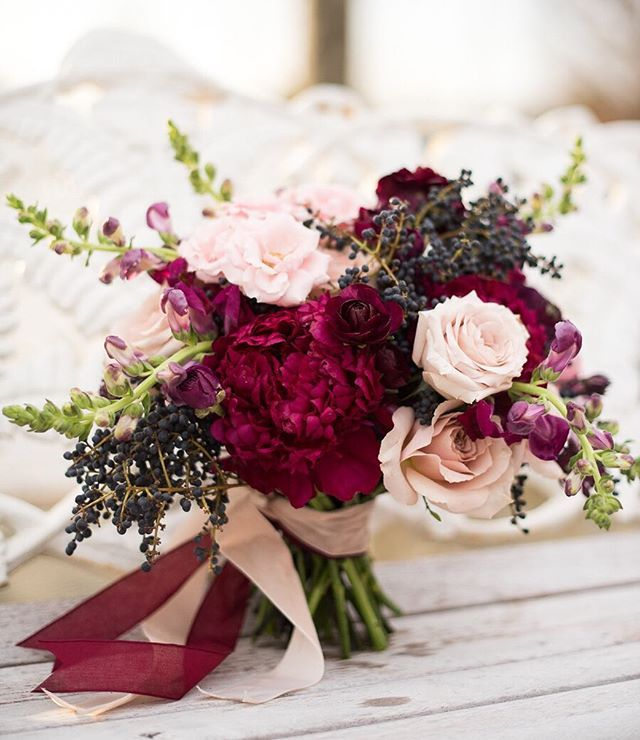 Lush, Hand Tied Wedding Bouquet Which Includes: Blush Roses, Fuchsia Peonies, Cranberry Ranunculus, Purple Snapdragons + Dark Blue Privet Berries