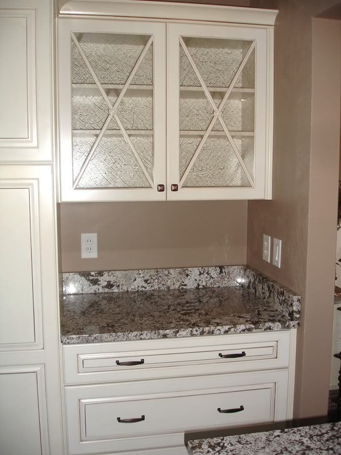 love the glass cabinet doors kraftmaid bianco antico granite
