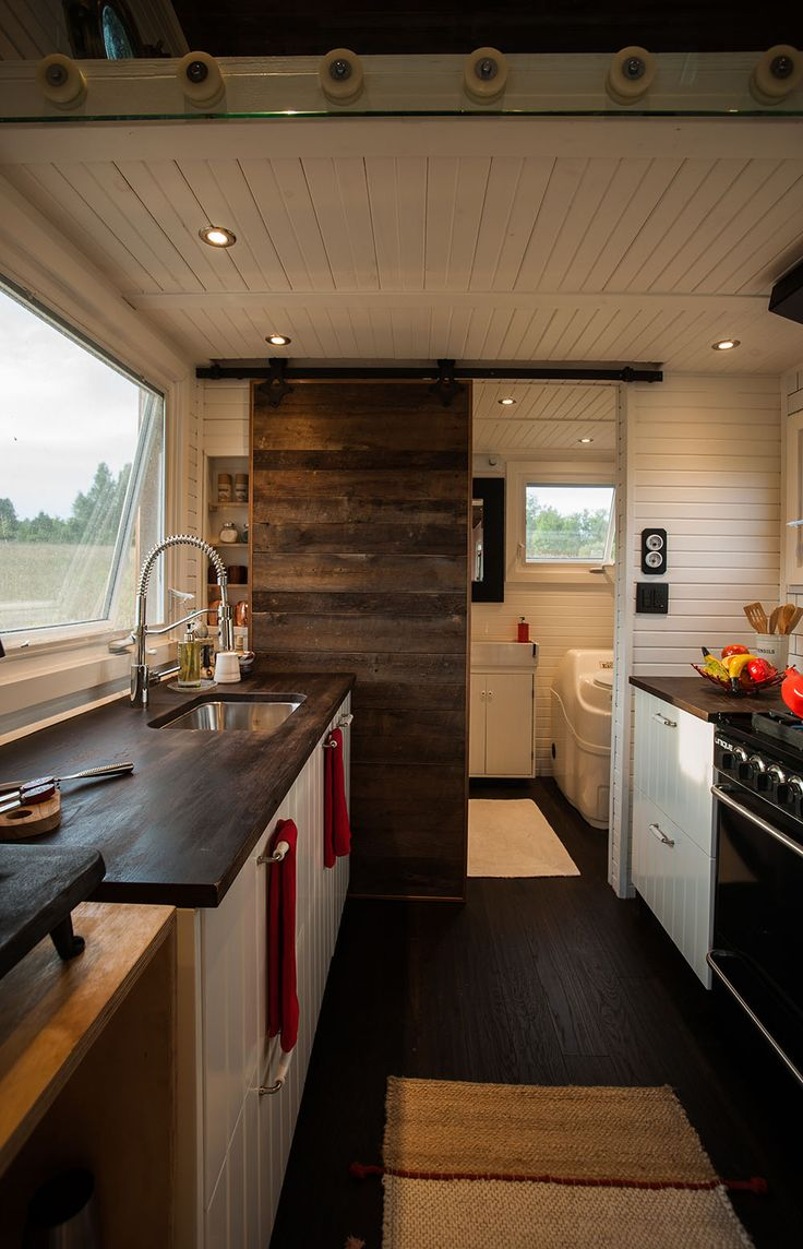View toward kitchen the alpha tiny home by new frontier tiny homes - An Off Grid Sustainably Built 340 Square Feet Tiny House On Wheels
