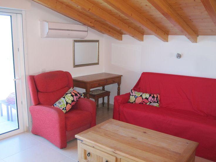 Living area with comfortable sofa and chairs and stunning views - Ria Formosa Apartment Casa do Mar Santa Luzia Tavira
