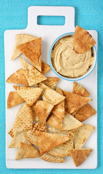 Baked pita chips brushed with olive oil and a sprinkle of sea salt, perfect for dipping at tailgates and parties.