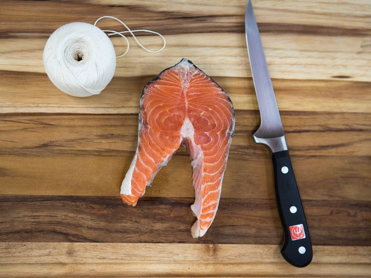 Grilling salmon steaks is, in theory, as simple as throwing them on the grill until done. But with a little prep work, you can make boneless rounds that cook more evenly and are easier to handle on the grill. Here's how.