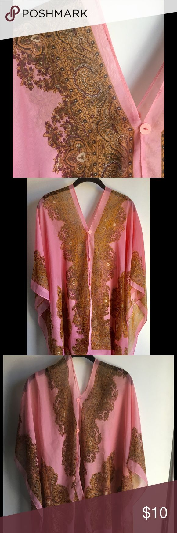 Pink and Gold Beach Cover Up / Tunic - OSFM Light, airy cover up or tunic. Pink with rich gold pattern and small buttons. One size fits most. Wear it over a bathing suit poolside. Throw on a pair of skinny jeans and heels and wear it to dinner. No tags. Purchased in Malaysia. Never worn. Reposh. Please submit reasonable offers via the 'Offer' function. NO negotiating in the comments section. NO trading or offline/alternate site transactions. All items from my closet, in a smoke-free…