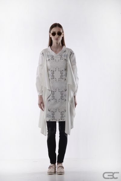 http://cbcdesign.ro/en/shop/vesta-milk/  Loose midi vest from white voile. Being very thin, it can be worn over any outfit, adding new dimensions through the illusion of layers.