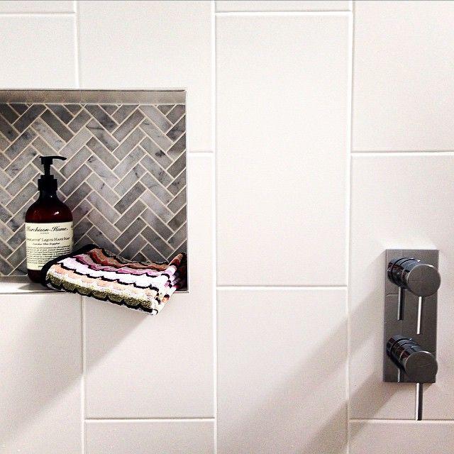 Amber Tiles Kellyville: pinned from Instagram (@christinaprescottdesign). Carrara herringbone feature with white wall tiles. #carrara #carraramarble #naturalstone #herringbone #herringbonetile  #featuretile #whitewalltile #bathroom #bathroominspiration #bathroominspo #ambertiles #ambertileskellyville  #bathroominspiration
