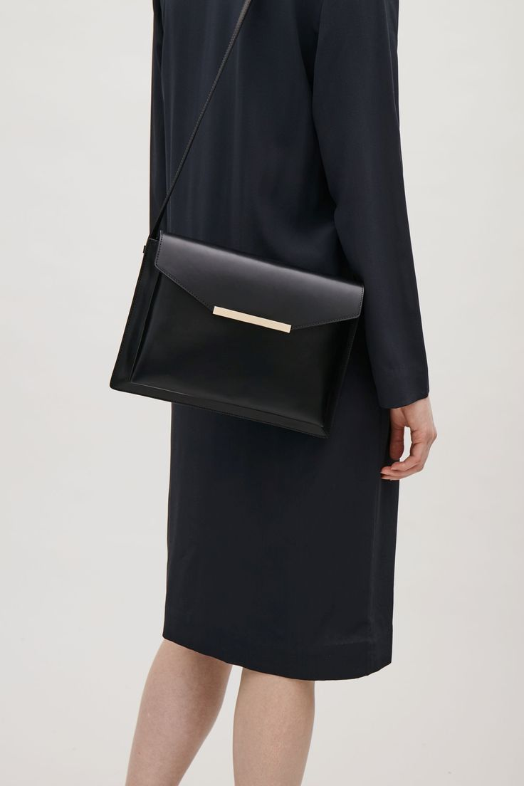 COS image 5 of Layered leather bag in Black