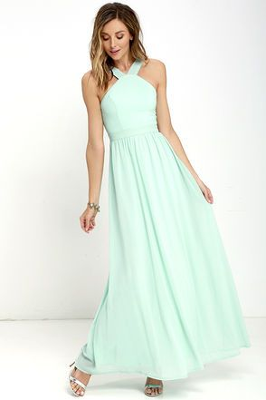 More romantic than a candlelit dinner or a trip to the Eiffel Tower, the Air of Romance Mint Maxi Dress will have you feeling the love! Lightweight Georgette falls from a modified halter neckline, into a seamed bodice supported by semi-sheer shoulder straps. A sweeping skirt cascades from a banded waist completing this elegant maxi dress. Hidden zipper with clasp.
