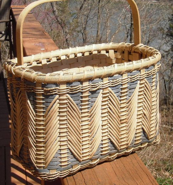 This is a one of a kind basket that is strong and sturdy. It is double woven, plain on the inside with a blue weave on the outside there is a