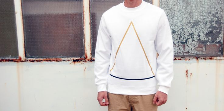 Sweatshirt Color: White 80% Cotton 20% Polyester Design: Gold Triangle