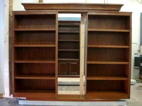 Sliding bookcase doors reveal hidden passage