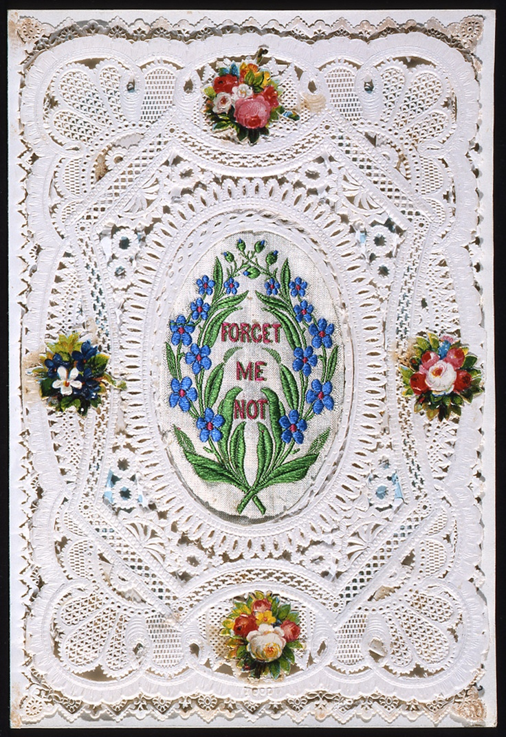 'Forget Me Not' Valentine Card. Paper lace valentine card with embroidered detail. White cameo embossed paper lace overlaid on blue and white embossed card with pretty design. Embroidered fabric panel in centre. Four embossed floral scraps. On front: 'Forget Me Not'. Handwritten message on reverse: 'For mother. Can you please send me my skates in a parcel'. c.1870 (OB1995.365)