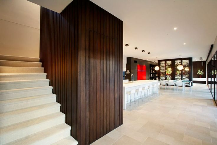 Radial Timber Lining Boards stained a dark chocolate brown have been used to great effect as feature walls in this modern home designed by DDB architects. Info: http://radialtimbers.com.au/portfolio-type/100mm-lining-ddb/