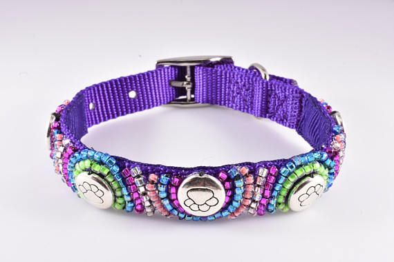 Purple dog collar is embellished with various colors of seed beads. These colors include blue, pink, peach, clear and neon green. Round silver beads, each with an embossed paw print, also adorn this collar. Such great colors in the design, gives a modern and hip twist to a blingy dog collar, the likes youve not fetched before. The collar is both fur fashion forward and colorful, a wonderful way to show to the world your love for your pawsomely special backyard barker. 🐾ALREADY MADE FOR YOU…