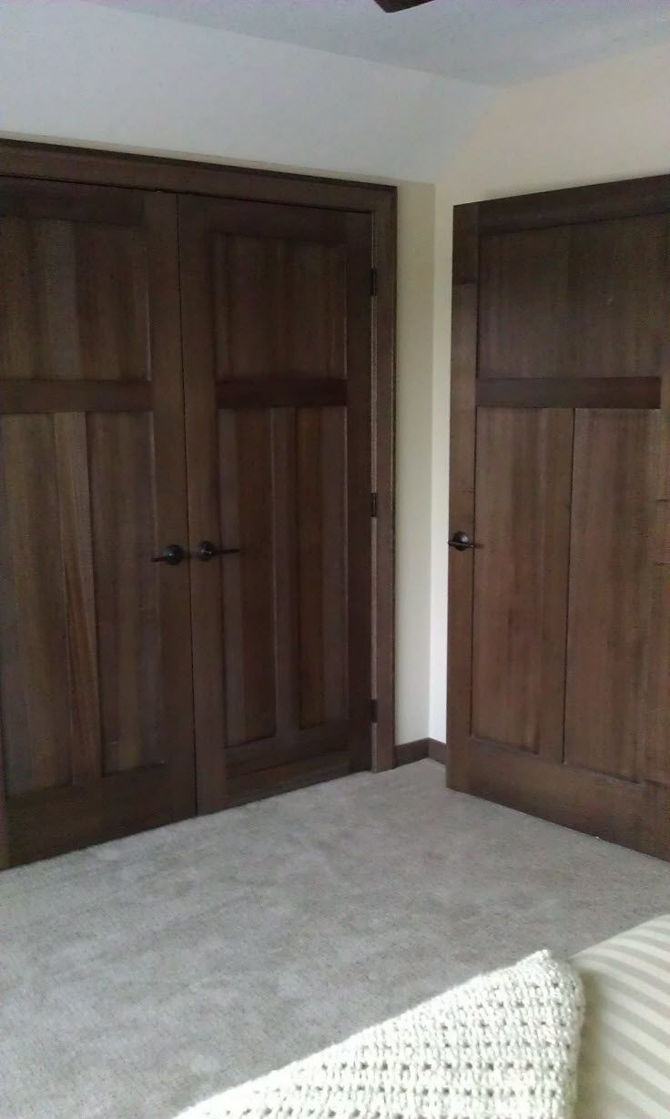 Interior doors dark stained wood panel doors complement a light colored home bayer