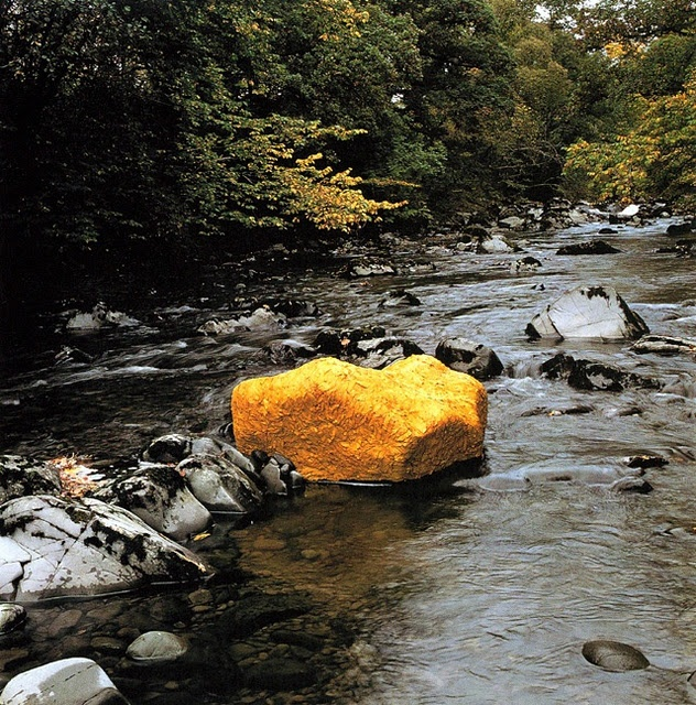 Andy Goldsworthy.  I really love Andy Goldsworthy art. This boulder probably covered in gold petals from a flower which he plastered on with water.  Very temporary.