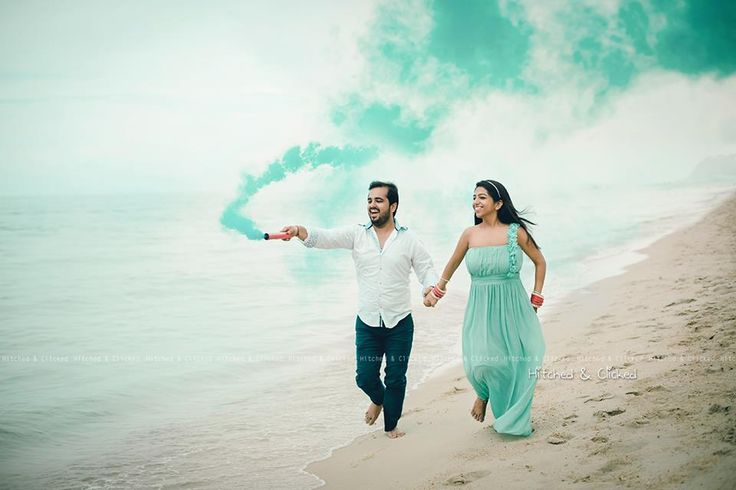 Have you noticed em yet? Creeping into many a pre wedding shoot are Smoke sticks- essentially a small cannon which gives out gorgeous wisps of color making your photo shoots rather magical. We have seen them in action in all types of pre wedding shoots- whether they are just held in the hand whil
