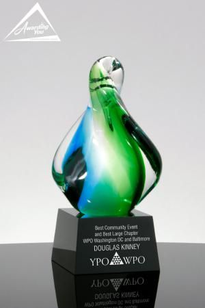 "The Waters Edge Blue and Green Art Glass Award is a lovely hand blown art glass award with a blue and green swirl inside the twisted wave of glass.  While only about 8"" tall, this award weighs an impressive 5 lbs and will make a wonderful addition to any awards program."