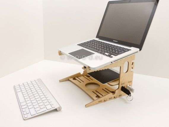 Laptop Organizer - Notebook Stand ... the perfect laptop station  Wood Design in perfect quality - no screws, no nails, no glue - precise click-joints 100% wood  Delivery: 1 x Laptop Stand - 15x Parking slot for USB stick (see picture) - Cable storage - Board for mouse and touchpad - keyboard holder  birch oil finish for self-assembly complete as shown incl. assembly instructions  Material: Birch, plywood, thickness 6.5 mm  Dimensions: Outside: 262 x 235 x 190 mm (BxTxH) Height front: 160…