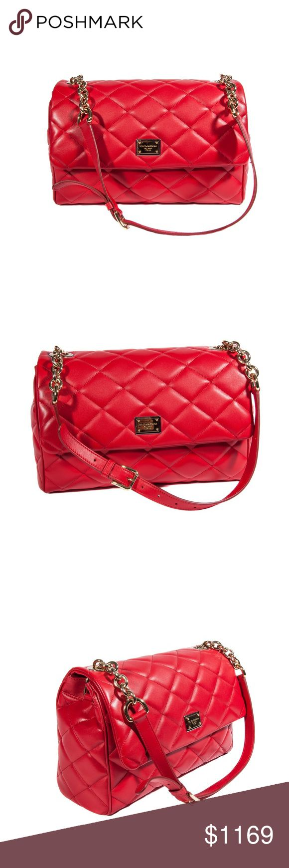 Dolce&Gabbana Red Quilted Shoulder Bag Dolce&Gabbana Red Quilted Shoulder Bag. Product details: Fancy shoulder bag. Great choice for your office outfits. Outside: leather quilted bag, metal logo plate on the front, flap with two magnetic snaps, long leather strap with metal chains. Inside: animal printed lining, one main compartment, a zipper pocket, two open pockets. Dolce & Gabbana Bags Shoulder Bags