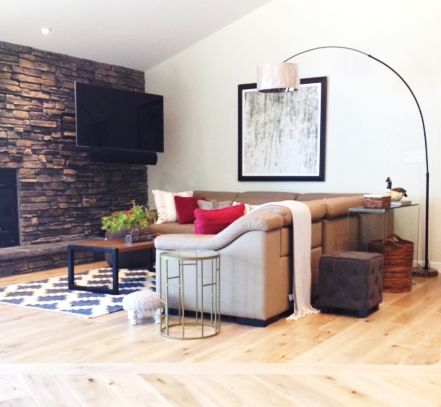cottage in thunder bay ontario with large stone fireplace and modern accents