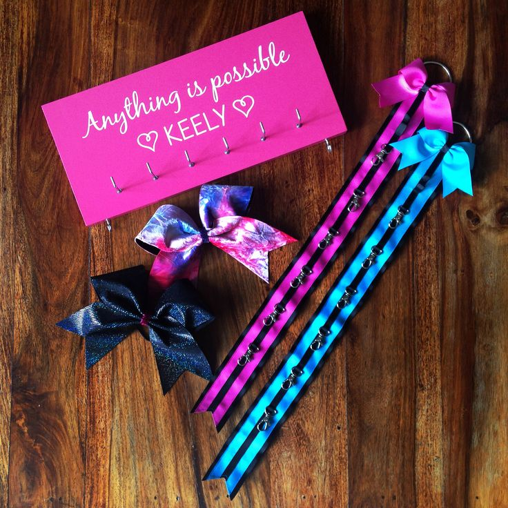 Custom gift set with personalised medal holder, cheer bow holders and cheer bows.