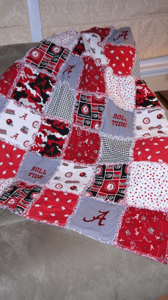 Beautiful cotton rag quilt displaying various Alabama material as well as embroidered gray squares displaying the infamous Alabama A and Roll Tide. This quilt measures 47 x 62 and would make a wonderful lap quilt for any Alabama fan!    Quilt is made of 3 layers with outside layers consisting of cotton fabric and an inner layer of cotton flannel. The backside of quilt is identical to the front except the gray squares on the back are not embroidered with Roll Tide or the Alabama A.