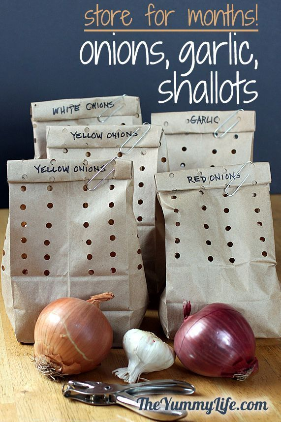 How to store onions, garlic, & shallots. This easy method keeps them fresh for months by punching holes in paper bags!