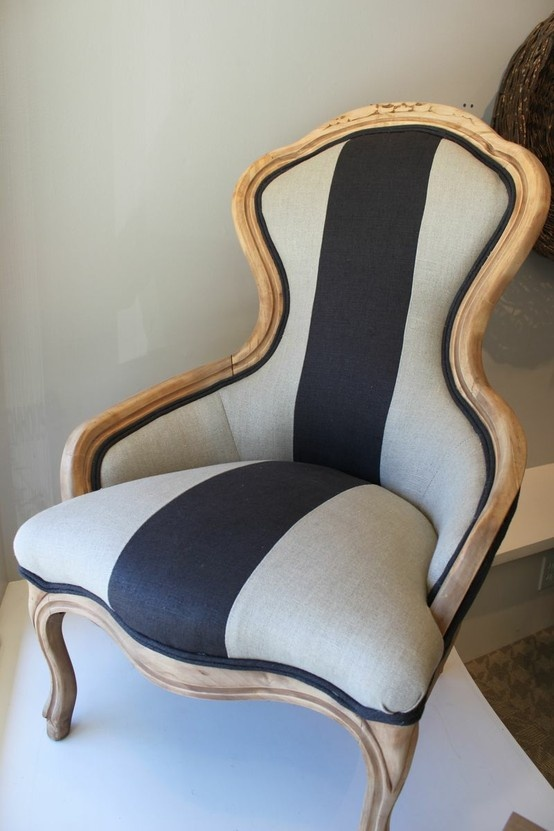 I like the juxtaposition of the modern fabric on the Victorian chair.   via Urban Farmhouse