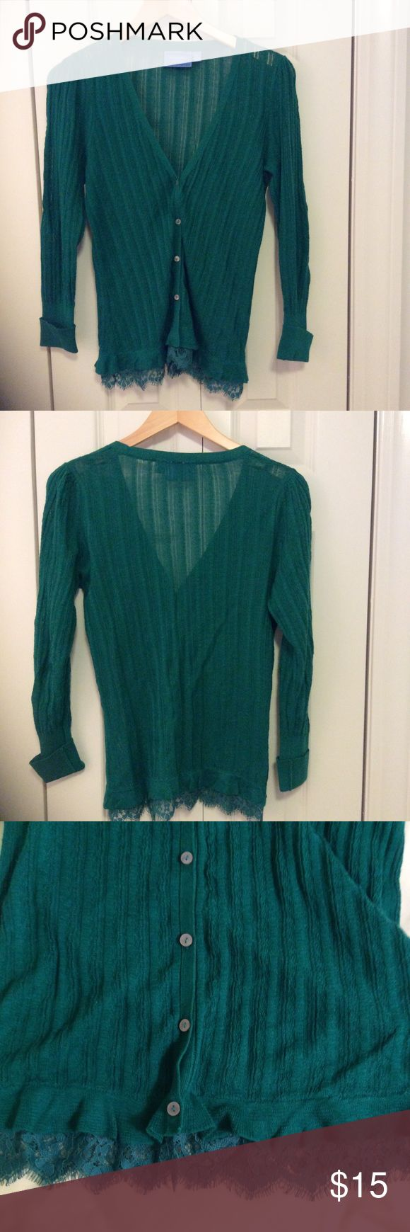 Simply Vera Green Cardigan This Simply Vera cardigan is emerald green with a lace detail along the edge. It's in good used condition.  From a smoke free, pet friendly home. No trades. Simply Vera Vera Wang Sweaters Cardigans