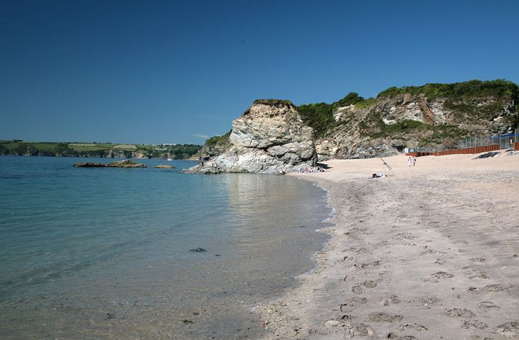 Carlyon Bay - St Austell. Fond memories of sitting in our car writing postcards to family while it was emptying down with rain outside! Apart from that, it was a nice holiday :)